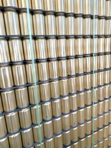 Pallet of beer cans with banding for storage
